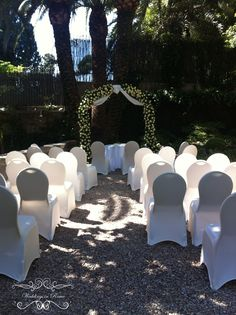 Arch with 200+ roses for Nadin and Dmitry's wedding ceremony at this exclusive 5 start hotel with garden in Rome. Beautiful! www.weddingsinrome.com