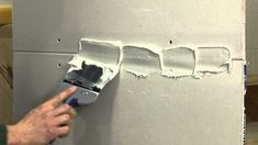 How to Tape and Mud Drywall. Many walls and ceilings in modern construction are made from sheets of drywall, also known as gypsum wallboard. Drywall is a plaster-like substance sealed between two sheets of heavy duty paper and attaches to. Drywall Tape, Drywall Mud, Drywall Repair, Plaster Repair, Drywall Ceiling, Remodeling Mobile Homes, Home Remodeling, Home Renovation, Drywall Finishing