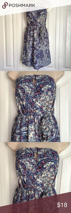 """Monteau strapless dress Paisley patterned strapless dress. Keyhole at bust, elastic waist with faux tie. Elastic around the top of bust. Skirt is lined. Bust is not lined. Inside hanger ribbons are attached. Length: 29.5"""" Bust laid flat: 16.5"""" Waist laid flat: 14"""". 100% polyester. New With Tags! WL075 Monteau Dresses Mini"""