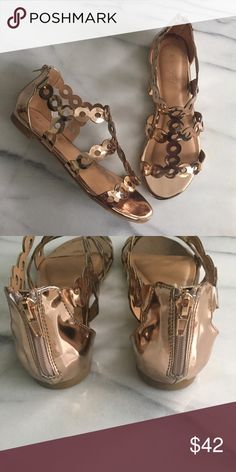 Rose Gold Scalloped Trim Strappy Flat Sandal This super cute and unique, metallic rose gold sandal features an open toe silhouette, scalloped trimming, laser circle cutout design, rear zipper closure, and lightly padded insole. Faux patent leather. Rubber sole. New in box. True to size, in my opinion. Shoes Sandals