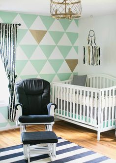 Modern, yet beautifully playful, this nursery decor idea in mint, black, and white is oh-so adorable. Integrate this stylish color palette—with help from BEHR paint—into a variety of rooms in your home for a cohesive look and feel.