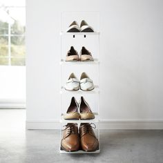 True to Japanese brand Yamazaki's minimal aesthetic, this sleek white shoe rack showcases clean lines, simply constructed shelves and undeniably simple allure. Featuring 5 neat levels, it's perfect for sorting shoes into categories or by owner and makes an invaluable addition to any home. Its sturdy metal frame is both portable and easy to lift, meaning you can move it from room to room as you see fit. An open design also allows shoes to air out when they've been exposed to rain or damp – place  Shoe Rack Tall, Slim Shoe Rack, Narrow Shoe Rack, White Shoe Rack, 5 Tier Shoe Rack, Narrow Shoes, Shoe Rack With Shelf, White Shoes, Shoe Shelves