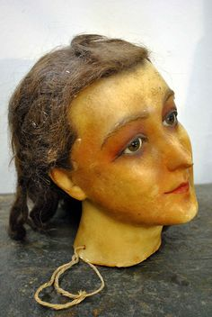 1900 wax head mannequin. Would have scared me to hide under the sheets when i was a kids but now i like it;)