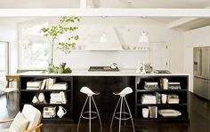 Jessica Helgerson    modern kitchen design with crisp white kitchen, tapered island pendants, espresso stained kitchen island with marble countertops and onda barstools.