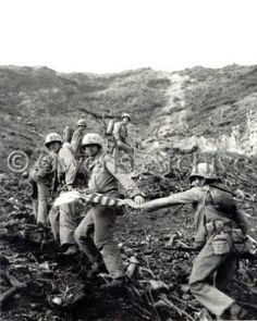 Six Marines of 3rd Platoon of Company E, 2nd Battalion, 28th Marine Regiment, 5th Marine Division, part of a patrol commanded by 1st Lieutenant Harold George Schrier, pass the flag to one another as they climb Iwo Jima. Included are two men carrying flamethrower backpacks.      One of those two men is Corporal Charles W. Lindberg (June 26, 1920 - June 24, 2007). The 54 x 28 inch flag, obtained from attack transport USS Missoula (APA-211) was raised on a 20-foot section of pipe at 1020 Hours…