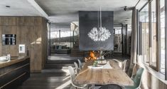 We visit a winter wonderhome in Austria: a traditional Tyrolean ski chalet expanded into an adjoining modern extension...