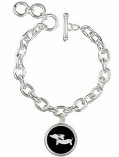 """Where your wiener dog love on your arm with our sterling silver plated charm bracelet featuring round charms in various colors. Lightweight 8"""" chain that is adjustable (7""""- 8"""") - The dimensions are .8"""