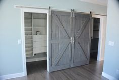 British brace sliding barn doors with grey stain. The hardware was stainless steel with boat cleats as handles. Built in Charleston, SC.