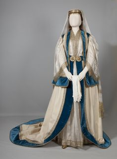 Costume worn by Queen Olga's ladies-in-waiting Athens, Attica. Mid 19th century © Peloponnesian Folklore Foundation, Nafplion, Greece The costume devised by Queen Olga for her ladies-in-waiting was inspired by the bridal costume of the Mesogeia region of Attica. Perhaps its most distinctive innovation was the addition of a long train, a feature Queen Olga imported from Russia and prescribed for the ladies of the court.