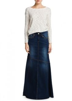 Flared denim long skirt in a dark wash embellished with studs. 38cfd221d951