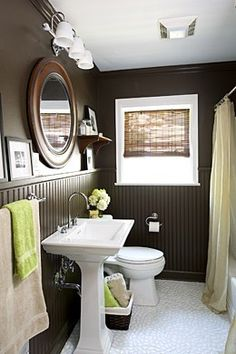 small bathroom. Love the chocolate and green accents. Would look great with the tree shower curtain we already have.
