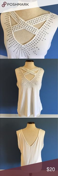 "Milano White Top w/Studs This top will make you feel like a million bucks.  The unique criss cross top is embellished with studs.  The back has a plunging V.  Pair with capris, shorts or jeans. Measurements (Flat):  Length - 25""/Bust - 23""/Waist - 21"" Milano Tops"