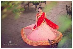 Pink lehanga with gold polka dots and border. Red dupatta and blouse with embroidery. Mrunalini Rao.