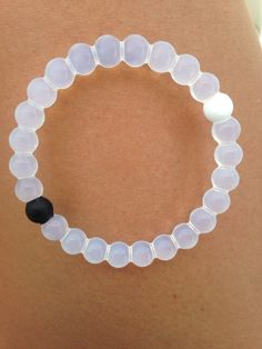 Lokia bracelet that is gorgeous  White- water from the highest point of Mount Everest  Black-dirt from the lowest part of the Dead Sea.  Both our highest and lowest points