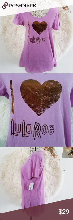 LULAROE Purple I Love Lularoe Classic Tee Medium The classic T is made from comfortable spun polyester jersey and is short sleeved with a high round neck line. The back is slightly longer to flatter bodies of all shapes and sizes. This measures about 17 inches pit to pit and 26 pinches long in front.  Thank you for looking and please check out my closet!  C8 LuLaRoe Tops Tees - Short Sleeve