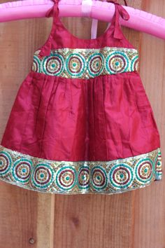 Gorgeous Indian baby clothes! Silk maroon baby outfit with gold sequin trim border, shoulder straps, perfect for summer on Etsy, $40.00 by PuchkeeBaby