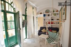 Beautiful room! Love the green doors.