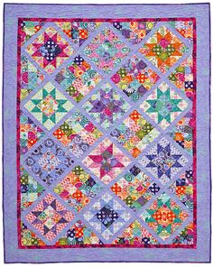 Another lovely star quilt.  I especially like the colors.