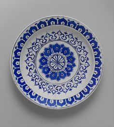 Dish with 'Kaleidoscope' design | Iznik, Turkey, ca. 1580-1585 | Stonepaste; polychrome painted under transparent glaze | Stylized variations of lotus petals, ultimately of Chinese inspiration but geometrically patterned into a radiating sunburst of powerful Islamic design, bear witness to one of the most fruitful cultural exchanges in history: the mutual influences between the artists, especially potters, of Eastern and Western Asia | The Metropolitan Museum of Art, New York