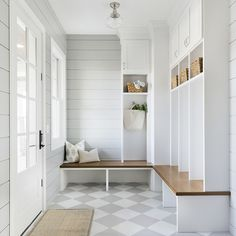 Classic farmhouse mudroom. Love the grey and white checkered floors with the touch of warmth with the wood bench. The Orono House | Bria Hammel Interiors