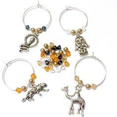 """""""Bay of Bengal"""" wine charms with Swarovski crystals colors inspired by the beautiful Bengal tiger. These are the perfect souvenir for someone traveling to India, Nepal, Bangladesh, or Thailand.   #wine #charms #tags #shopsmall #handmade #onabudget #etsy #levito #charming #oneofakind #design #beaded #swarovski #wedding #bridal #bridesmaid #bachelorette #birthday #housewarming #gift #decor #decoration #party #favor #shower #present #travel #souvenir"""