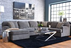 Fantastic Grey Brick Walls Of Small Apartment Living Room Design With U Shaped Grey Fabric Sofa And Glass Coffee Table Using Chrome Polished Steel Frame On Navy Blue Rug, Exquisite Interior Brick Walls Design Ideas: Interior