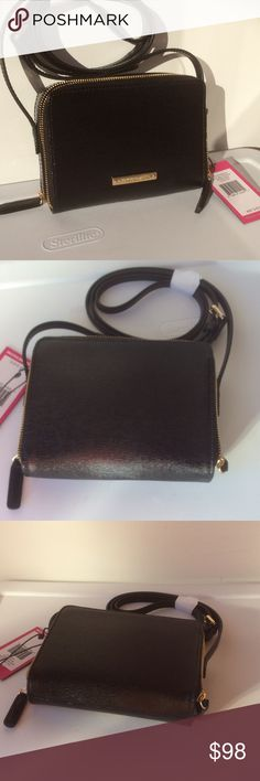 "NWT 🔶Vince Camuto Crossbody It's really true that less is more with this sized-down leather bag.  * Hisksa textured shiny Leather - 52"" adjustable strap for shoulder or cross body wear - Dual wraparound zip top closures - Interior features 12 card slots                              - Lined.                                                                 - - Dust bag included.                                                - Fits iPhone 6s - Approx. 5"" H x 6 1/2""W x 1  1/2"" D Vince Camuto…"