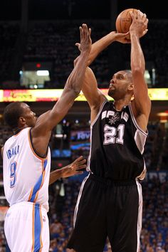 Tim Duncan Photos Photos - Tim Duncan #21 of the San Antonio Spurs shoots over Serge Ibaka #9 of the Oklahoma City Thunder in the first quarter in Game Four of the Western Conference Finals of the 2012 NBA Playoffs at Chesapeake Energy Arena on June 2, 2012 in Oklahoma City, Oklahoma. NOTE TO USER: User expressly acknowledges and agrees that, by downloading and or using this photograph, User is consenting to the terms and conditions of the Getty Images License Agreement. - San Antonio Spurs…
