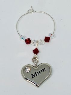 Mum Garnet Wine Glass Charm - set with a silver plated heart engraved with Mum - finished with Garnet and Clear Swarovski Crystals Garnet is the birthstone for January Gifts For Mum, Mother Day Gifts, Cooking With White Wine, Beaded Jewelry, Handmade Jewelry, Wine Glass Charms, Heart Charm, Birthstones, Garnet