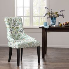 Gently sloped arms and confident lines give this versatile dining armchair a subtle sophistication.