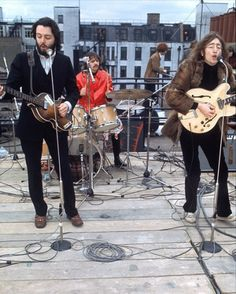 The Beatles performing on the roof of the Apple building for 'Let It Be.'