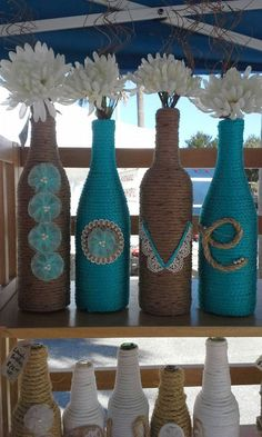Upcycled Rope wrapped Wine Bottles as a wedding Decor. These adorable rope wrapped wine bottles with the letters to spell LOVE are wonderful for a wedding with flowers in. Wine Bottle Art, Diy Bottle, Wine Bottle Crafts, Rope Crafts, Jar Crafts, Garrafa Diy, Wrapped Wine Bottles, Twine Bottles, Yarn Bottles