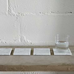 Polished Carrara marble coasters make a beautiful statement while protecting your tabletop. Coasters come in a set of 4, and each piece has cork glides on the bottom. FREE delivery via UPS within the lower 48. At this time we are not able to ship outside of the US.