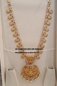 Every day new designs added in Long harams by Sri Mahalaxmi Gems and Jewellers. Presenting Haram with Detachable locket. Long haaram with Ram parivar kasu hangings. Visit for best designs at direct Manufacturers price. Contact no 8125 782 08 June 2019 Wedding Jewellery Designs, Gold Jewellery Design, Diamond Jewellery, Real Gold Jewelry, Gold Jewelry Simple, Indian Bridal Jewelry Sets, Bridal Jewellery, Indian Jewelry, Gold Pendant