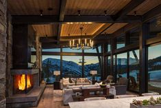 Mountain Peek is a custom designed modern-rustic mountain home by Centre Sky Architecture, located within the Yellowstone Club in Big Sky, Montana. Cozy Family Rooms, Family Room Design, Indoor Outdoor, Outdoor Decor, Montana Homes, Modern Rustic Homes, Modern Lodge, Mountain Modern, House And Home Magazine