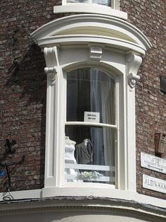 Windows bent around corners are some of my favourite architectural features.    York, England