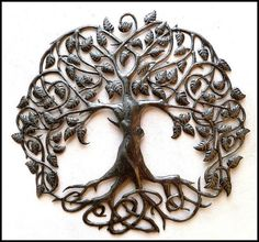 """Steel Drum Metal Wall Hanging - Tree Design - Tree of Life - Garden Decor - 34"""" The fine details of this piece are difficult to show on a picture. The Haitian metal artist draws the design on a flattened steel drum and cuts the design with a hammer and chisel. Fine detail work is then applied to the leaves, birds etc with hundreds of tiny dots and other shapes, created with a hammer and nail. This is a true work of art. Something that you will be proud to hang in your home."""