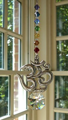 "Crystal Sun Catcher with Pewter OM, Yoga Studio Decor, Swarovski Crystal Strand and Pendant, Chakra Colors, Suncatcher for Car or Home ""Om"" Feng Shui, Suncatchers, Yoga Studio Decor, Chakra Colors, Hanging Crystals, Wind Spinners, Swarovski Crystal Beads, Mobiles, Wind Chimes"