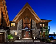 """Stone and wood exterior with overhang..""""  """"Interesting entry. Like the clear cedar soffit."""