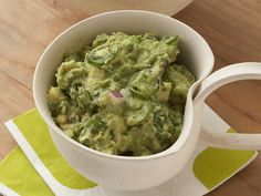 Tyler Florence's guacamole marries creamy and spicy thanks to serrano chiles stirred into the avocados. Just make sure to cover tightly with plastic wrap to prevent browning!