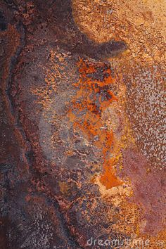 Pictures of Iron Rusting   Rust forming on an Iron plate creating a textured background. .
