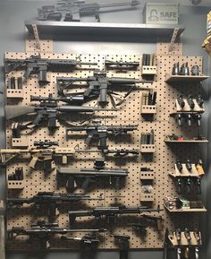 filling up the gallow wall with some epic firearms! Weapon Storage, Gun Storage, Weapons Guns, Guns And Ammo, Zombie Weapons, Tactical Wall, Tactical Gear, Gun Vault, Hidden Gun