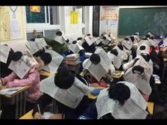 Chinese students exam wearing 'anti-cheating hats' made out of newspapers