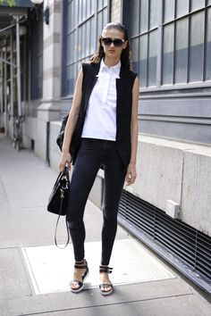 Shop+this+look+on+Lookastic:  http://lookastic.com/women/looks/sunglasses-and-sleeveless-button-down-shirt-and-sleeveless-blazer-and-crossbody-bag-and-skinny-jeans-and-handbag-and-flat-sandals/3483  —+Black+Sunglasses+ —+White+Sleeveless+Button+Down+Shirt+ —+Black+Sleeveless+Blazer+ —+Black+Canvas+Crossbody+Bag+ —+Charcoal+Skinny+Jeans+ —+Black+Leather+Handbag+ —+Black+Leather+Flat+Sandals+