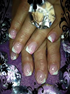 Classic french with baby pink swirl and shimmer. Hand-painted nail art. Sculpted gel nails  www.facebook.com/LizellesGelNails