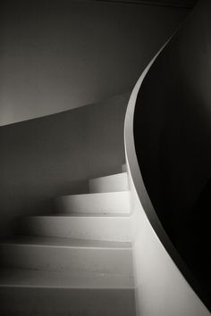 not my usual rustic choice, but I love the clean, spare lines of the curving stairs
