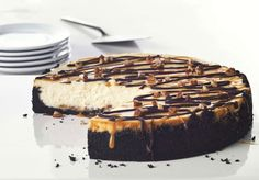 Ultimate Turtle Cheesecake with OREO cookies, caramel, pecans and chocolate.