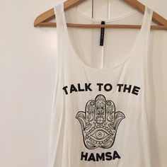 Talk To The Hamsa Top Talk to the Hamsa! ✋ Brand new. Never worn. Runs true to size for an oversized loose fitting look. Would look super cute with a lace bralette underneath. Available in S-M-L. No Paypal. No trades. 10% discount on all bundles made with the bundle feature. No offers will be considered unless you use the make me an offer feature.      Please follow  Instagram: BossyJoc3y  Blog: www.bossyjocey.com Tops Tank Tops