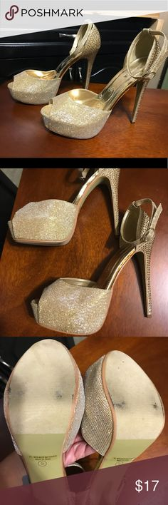 Gold Stilettos All that Glitters in Gold. Worn on two occasions no heal wear on these beautiful Gold Glitter and rhinestone size 9 stilettos. There shows in pic small discoloration on back of heel zoomed in to show but not very noticeable if I didn't point it out. Make a statement in these shoes for whatever your occasion out is. Perfect one nighters Prom Wedding Club Night out Shoes Heels