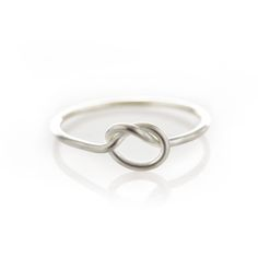 Thin sterling silver ring with a center knot.Please check our info page for more details on ring sizes. Sterling Silver Rings, Silver Jewelry, Gifts For My Wife, Delicate Jewelry, How To Show Love, Girls Best Friend, Heart Ring, Bling, Knot
